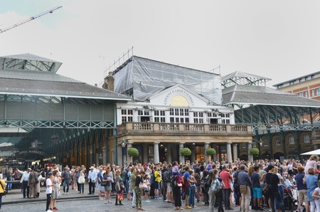 covent: Covent Garden London England, United Kingdom - August 16, 2016: Large crowd in centre of Covent Garden Central London Editorial