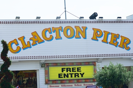 garish: Clacton on Sea , United Kingdom - August 26, 2016: Sign for entry to Clactons Pier Editorial