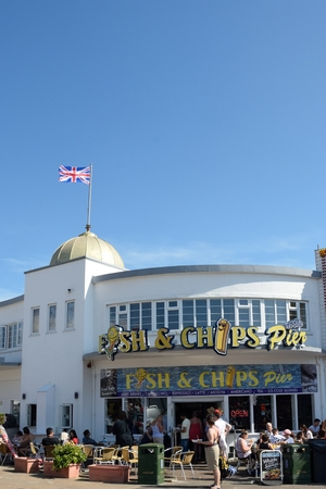 Clacton on Sea , United Kingdom - August 26, 2016: Fish and Chip shop advertised on Clacton Pier in portrait aspect