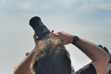 Clacton on Sea , United Kingdom - August 26, 2016: Man pointing Camera to sky at Clacton free  airshow 2016