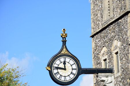 Antique clock on norman tower Stock Photo