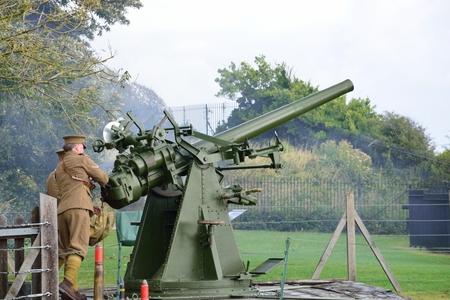 Dover, United Kingdom - October 1, 2016: Man firing world war two  anti aircraft gun in re-enactment