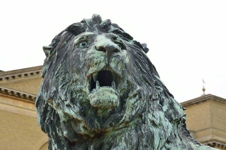 stately home: Statue of Lions Head with stately home in background