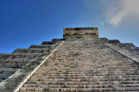 itza: Steep steps leading up chichen itza temple in bright sun Stock Photo