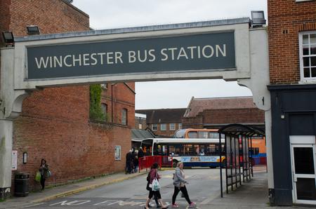 above 21: Winchester  United Kingdom -21 April 2017: Bus station sign above Winchester Bus Station Editorial
