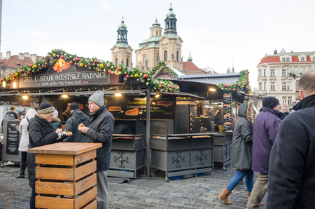 Prague  Czech Republic  -5 December 2017: Large Group Tourists in Old Town Hall square Christmas market food stalls