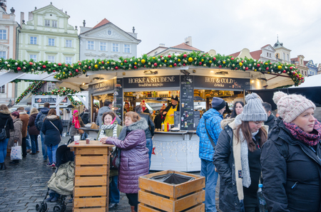 Prague  Czech Republic  -5 December 2017: Large Group Tourists in Old Town Hall square Christmas market
