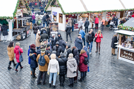 Prague  Czech Republic  -5 December 2017: Large Group Tourists in Old Town Hall square for Christmas Market Editorial