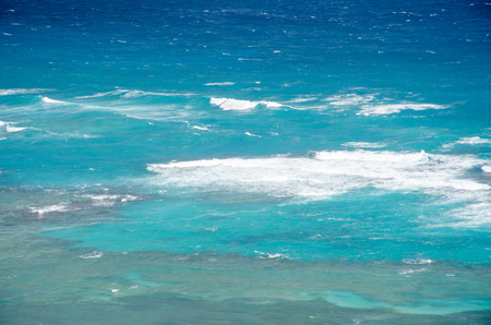 Bright Bllue Ocean with white waves in Caribbean