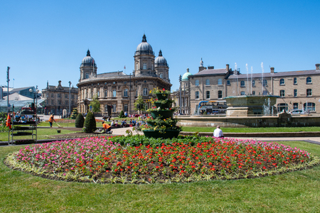 Hull Yorkshire UK - 27 June 2018: Hull Dock Offices with town park in foreground