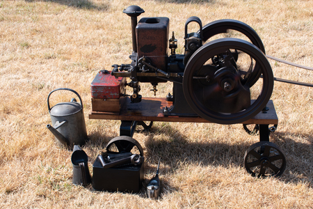 Steam engine with watering can next to it Stock Photo