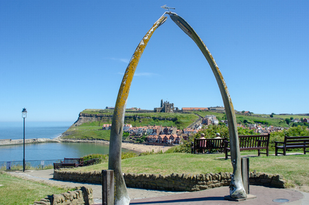 Whitby Yorkshire UK  - 25 June 2018: Looking down on Whitby through Whalebone sculpture