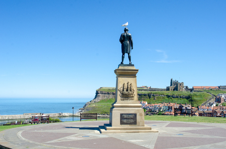 Whitby Yorkshire UK  - 25 June 2018:  Statue of Captain Cook overlooking the town of Whitby