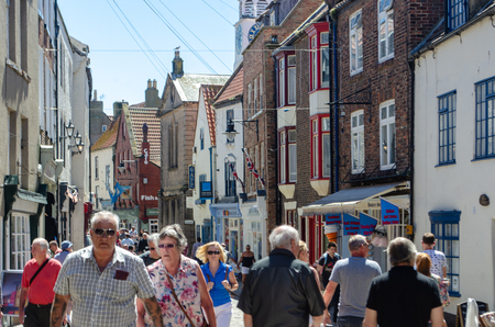 Whitby Yorkshire UK  - 25 June 2018: Crowded street in Whitby popular tourist town