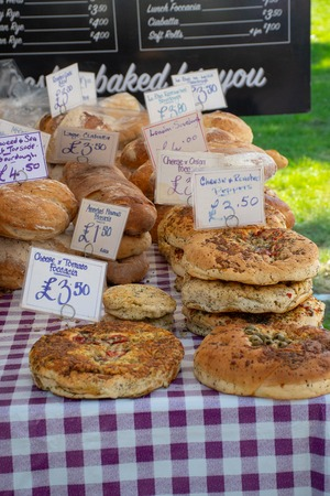 Chelmsford Essex UK  -2 September 2018: Large selection of Artisan home cooked bread with price tags for sale