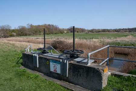 Wrabness Suffolk Uk  - 1 April  2019:  Flood control sluice used for water management near coast