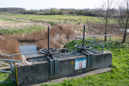 Wrabness Suffolk Uk  - 1 April  2019:  Flood control sluice used for water management