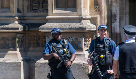 Parliament United Kingdom  -12 May 2019: Armed police on Guard at Buckingham Palace