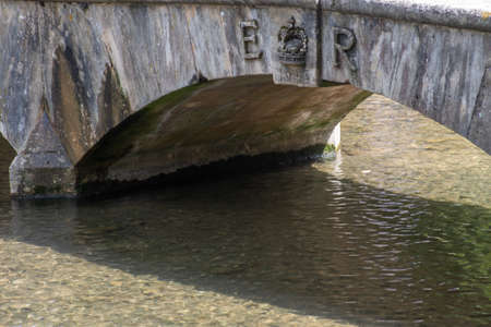 Traditional stone bridge over stream celebrating Queens Coronation