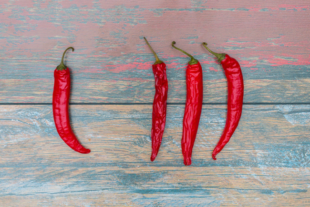 capsaicin: Chili peppers on the table Stock Photo