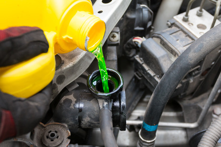 coolant: Pouring coolant Stock Photo
