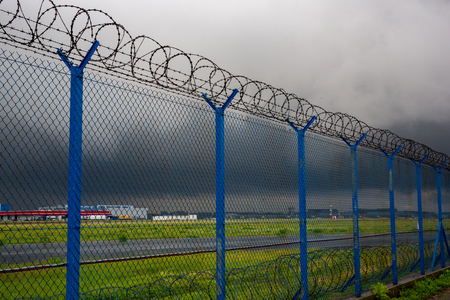Barbed wire - restricted area Stock Photo