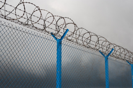 restricted area: Barbed wire - restricted area Stock Photo