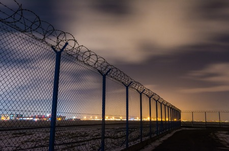 Fence with barbed wire, restricted area *** Local Caption *** Fence with barbed wire, restricted area Stock Photo