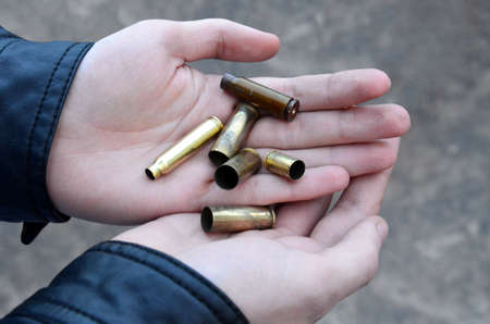 Ammunition cartridges on the palms