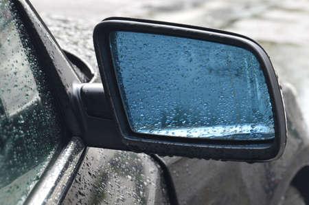 external: External car mirror in raindrops
