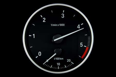 tachometer: Round tachometer on black background