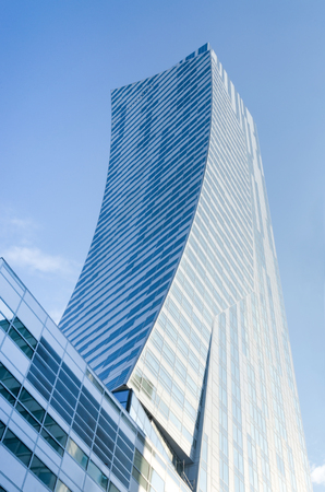 residencial: Warsaw, Poland - May 30, 2015: Zlota 44 residencial skyscraper designed by famous Polish-born American architect Daniel Libeskind. It is 192 meters high, and has 52 storeys.