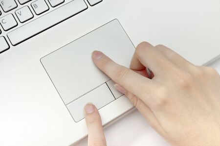 Human hands working on touchpad top view Stock Photo