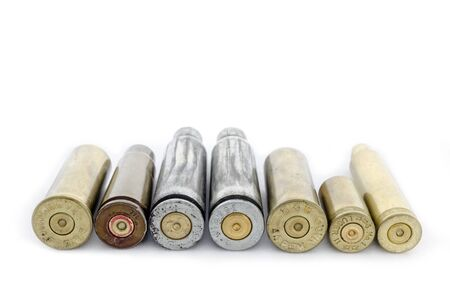 9mm ammo: Cartridges of different caliber lying in the range; isolated
