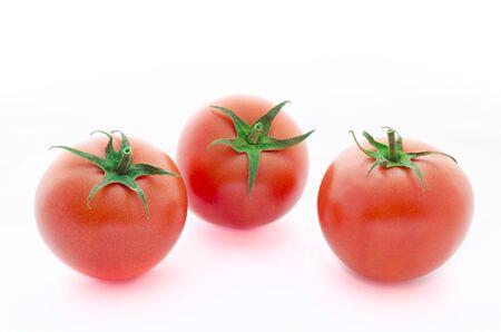 Three fresh raspberry tomatoes isolated on white background