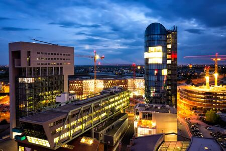 Business center under construction in Dusseldorf city at night. Nightscene Dusseldorf panorama photo Stock Photo