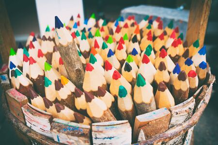 one person with others: One of the pencils selected among the heap of others. Business concept in choosing ideal person from many candidates. Selective focus. Vintage style Stock Photo