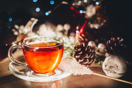 Merry christmas poster for cafe or restaurant with cup of hot tea with copy space 写真素材