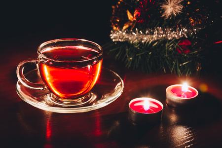 Tea cup on the table near christmas tree