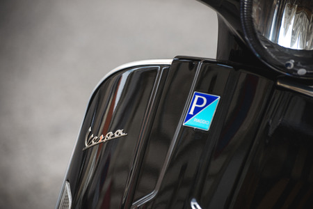 Vienna, Austria - July 18, 2018: Close up detailed view of modern black Vespa scooter with logo by Piaggio 報道画像