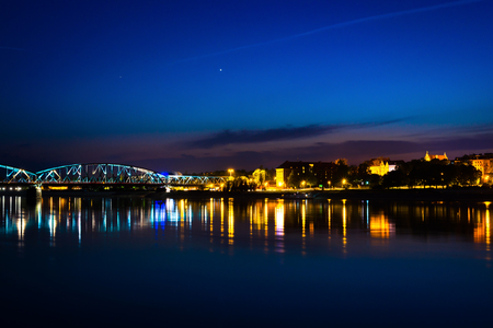 Bridge over Vistula river near Torun city with reflection of night sky in the water 写真素材