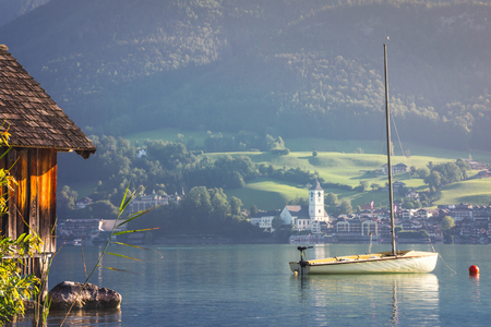 Sailboat on Alpine lake at the mountain valley