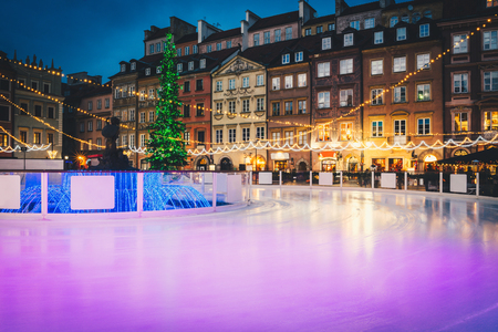 Ice skating near Christmas tree. Ice rink in the centre of capital city