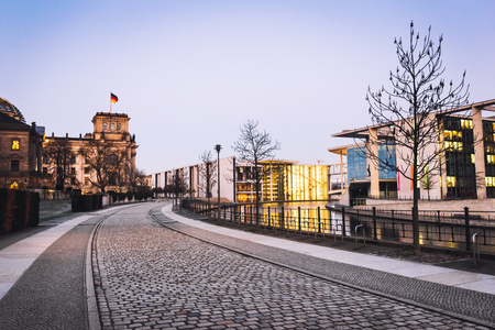 Early morning in Berlin. Street leading to Reichstag building. Urban cityscape