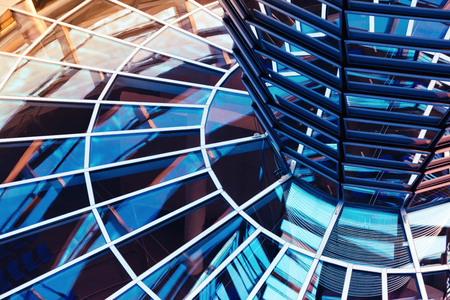Windows inside the glass dome on the roof of Reichstag building in Berlin. Abstract business background