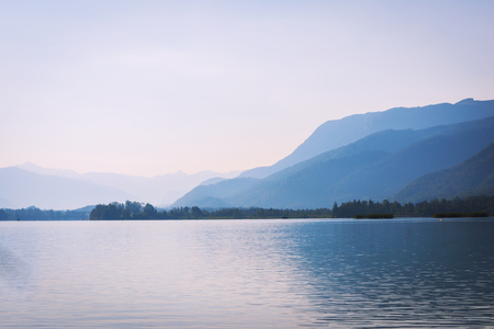 Tranquil landscape of lake in mountains at early morning before sunrise