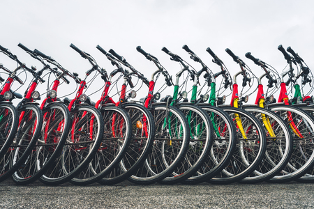 Bikes standing in a row on the city street