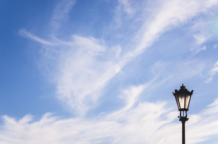 Surrealistic lonely lantern at the sky background; Minimal abstract background