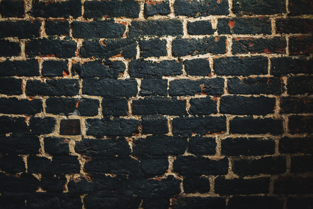 Wall from old burned brick.Texture background; Old aged brick wall
