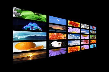 Color multidisplay on black wall, tv, monitor photo